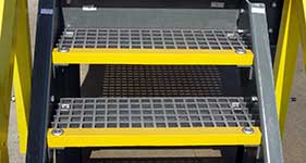 fiberglass-grating-stair-treads-with-nosing and hold down clamps