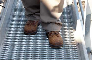 Grip-Strut-Grating-Walkway-man walking