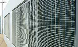 bar grating infill panels on wall